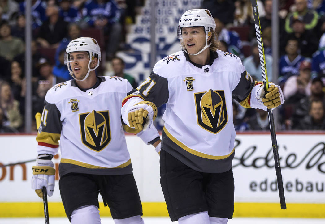 Vegas Golden Knights' William Karlsson, right, of Sweden, and Jonathan Marchessault celebrate Karlsson's goal against the Vancouver Canucks during the first period of an NHL hockey game Thursday,  ...