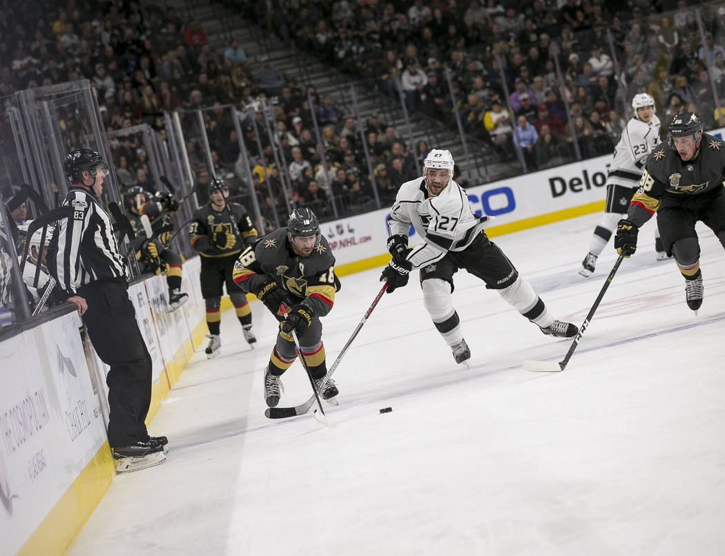 Vegas Golden Knights left wing James Neal (18) and Los Angeles Kings defenseman Alec Martinez (27) follow the puck during the third period of an NHL hockey game at the T-Mobile Arena in Las Vegas  ...