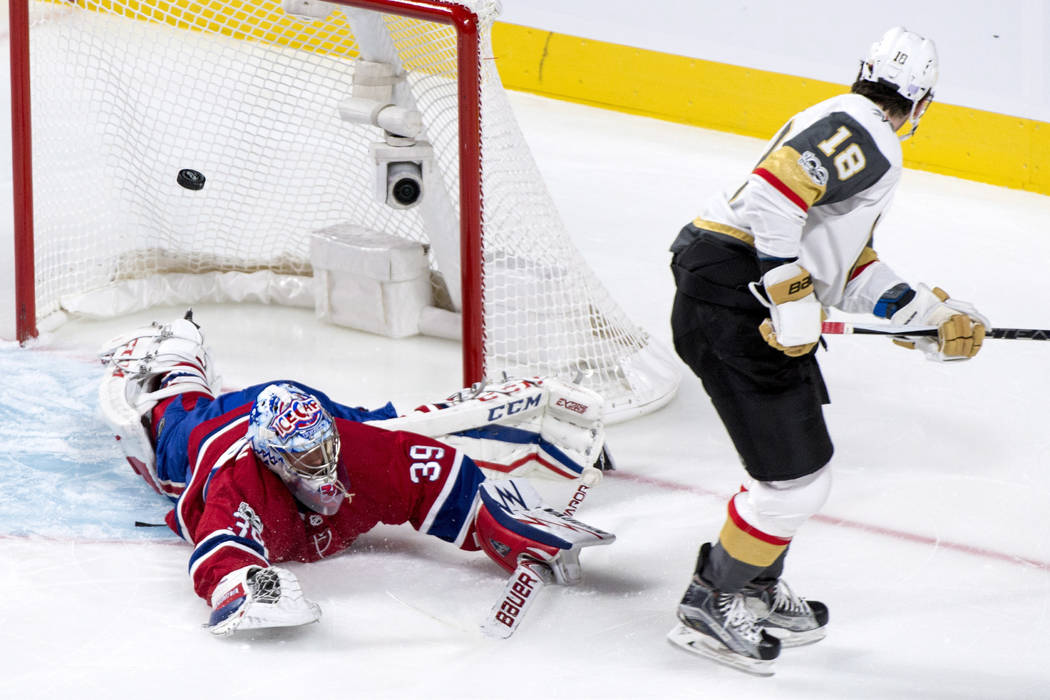 Montreal Canadiens goalie Charlie Lindgren dives to deflect a shot from Vegas Golden Knights' James Neal during the first period of an NHL hockey game, Tuesday, Nov. 7, 2017, in Montreal. (Paul Ch ...