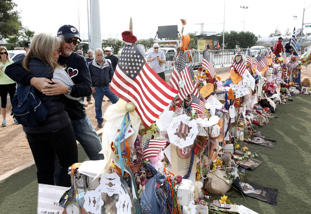 Chris Davis and his wife Debbie visit a memorial cross for their daughter Neysa Tonks at the Welcome to Fabulous Las Vegas sign Sunday, Nov. 12, 2017. Fifty eight crosses and items that were erect ...