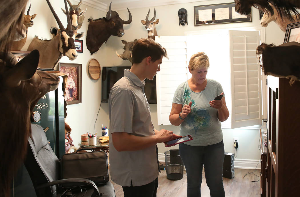 Hudson Root, left, helps Kai Otterson set up devices at her Henderson home on Wednesday, Nov. 22, 2017. Root started a community service project called Geeks for Seniors as a way to pair up techno ...
