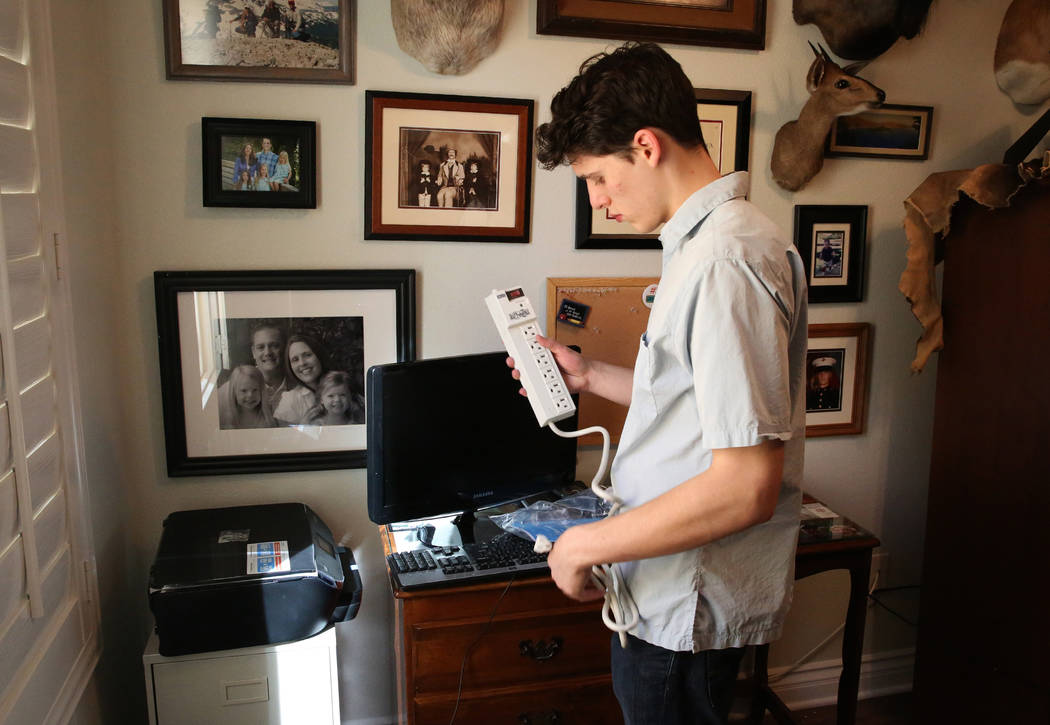 Hudson Root prepares to set up Kai Otterson's new wireless printer at her Henderson home on Wednesday, Nov. 22, 2017. Root started a community service project called Geeks for Seniors as a way to  ...