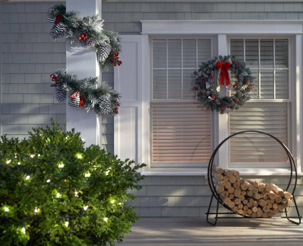 Home Depot Clear lights on bushes present a festive look any time of year, while a snowy garland can be left up all winter long.