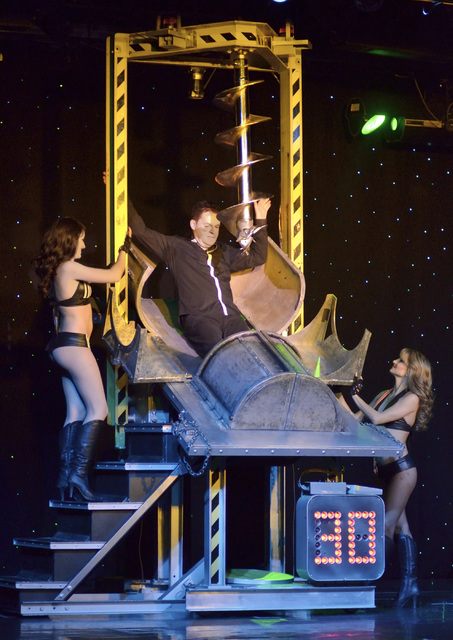 "Magician Dirk Arthur, center, performs with dancers Destiny Johnson, left, and Lauren Metter in ""Dirk Arthur's Wild Illusions"" at the Riviera hotel-casino at 2901 Las Vegas Bl ..."