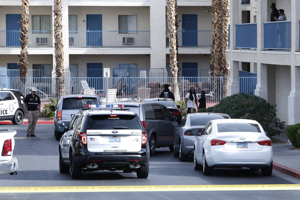 Las Vegas police investigate an incident that left one child dead and a teenager in critical condition at the Budget Suites extended-stay motel, 8440 Las Vegas Blvd. South, on Monday, Nov. 20, 201 ...