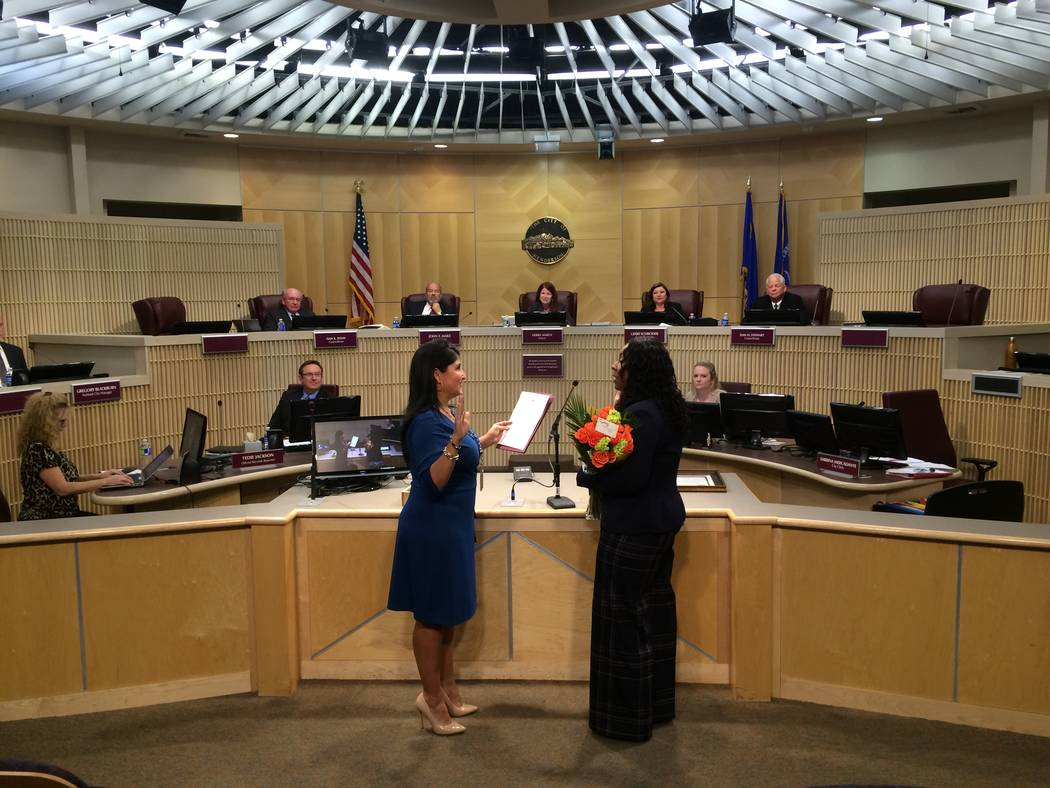 Henderson City Clerk Sabrina Mercadante, left, administers a ceremonial oath of office to newly appointed Police Chief LaTesha Watson. (City of Henderson/David Cherry)