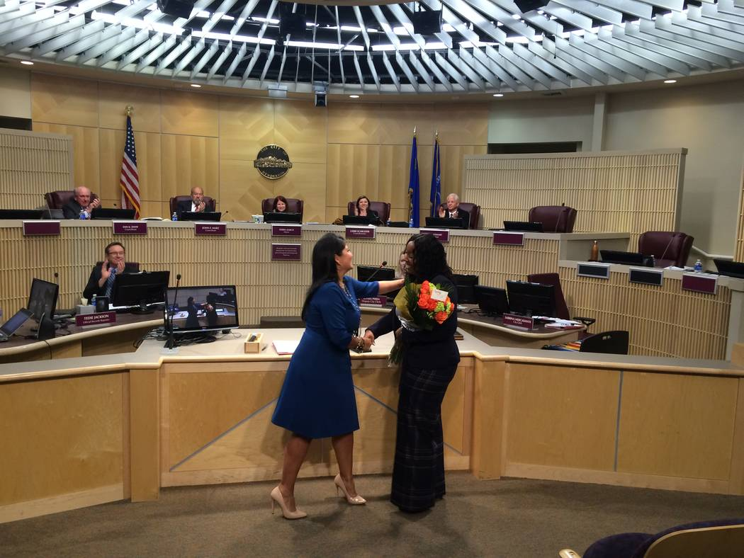 Henderson City Clerk Sabrina Mercadante hugs newly appointed Police Chief LaTesha Watson after administrating a ceremonial oath of office. (City of Henderson/David Cherry)
