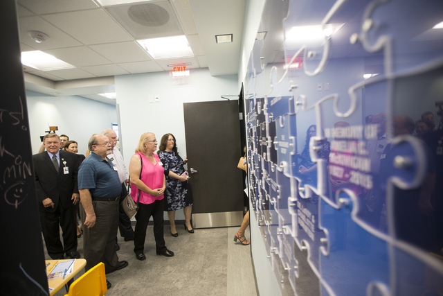 People tour the Sharon Sigesmund Pierce and Stephen  Pierce Center for Autism and Developmental Disabilities at Touro University Nevada on Wednesday, June 29, 2016, in Henderson. (Erik Verduzco/La ...