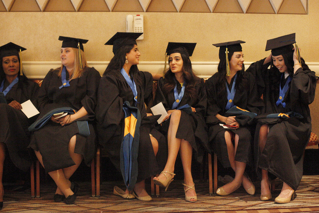Touro University Nevada graduates wait in a ballroom for their graduation ceremony at the Rio Hotel and Casino Sunday, May 15, 2016. Rachel Aston/Las Vegas Review-Journal Follow @rookie__rae