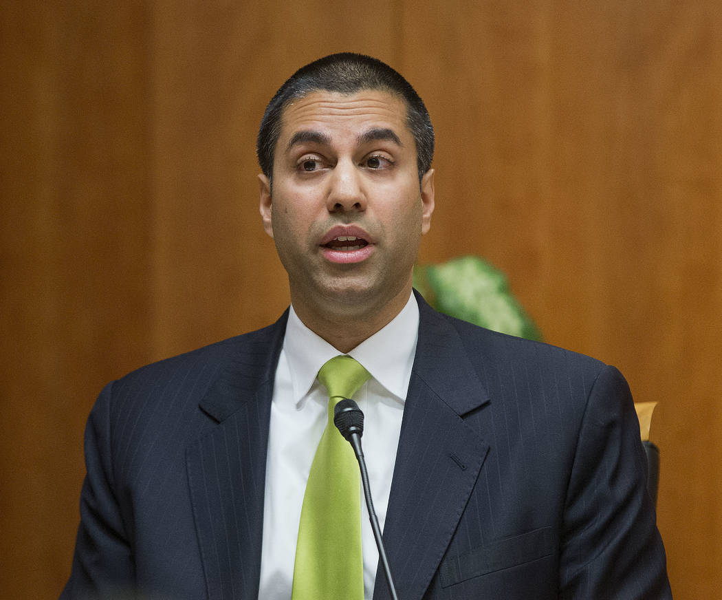 """Federal Communication Commission Commissioner Ajit Pai speaks during an open hearing and vote on """"Net Neutrality"""" in Washington on Feb. 26, 2015. Federal Communications Commission Chairman Ajit Pa ..."""
