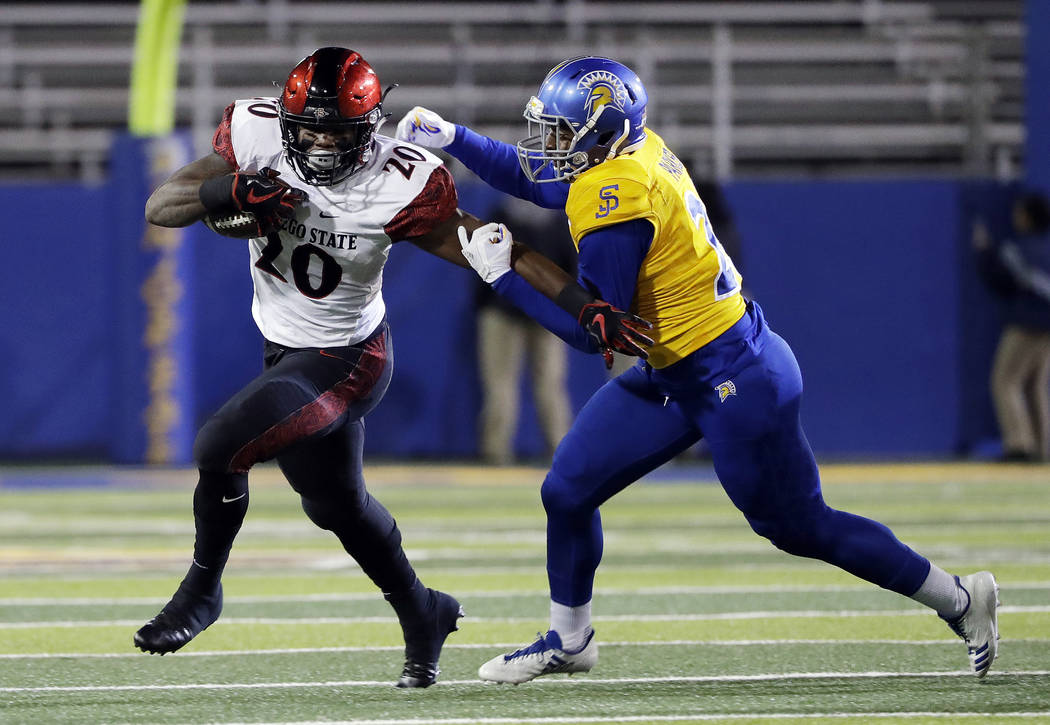 San Diego State running back Rashaad Penny, right, runs against San Jose State during an NCAA college football game against San Jose State Saturday, Nov. 4, 2017, in San Jose, Calif. (AP Photo/Mar ...