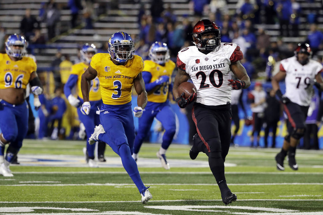 San Diego State running back Rashaad Penny (20) rushes for a touchdown past San Jose State cornerback Jermaine Kelly (3) during the second half of an NCAA college football game Saturday, Nov. 4, 2 ...