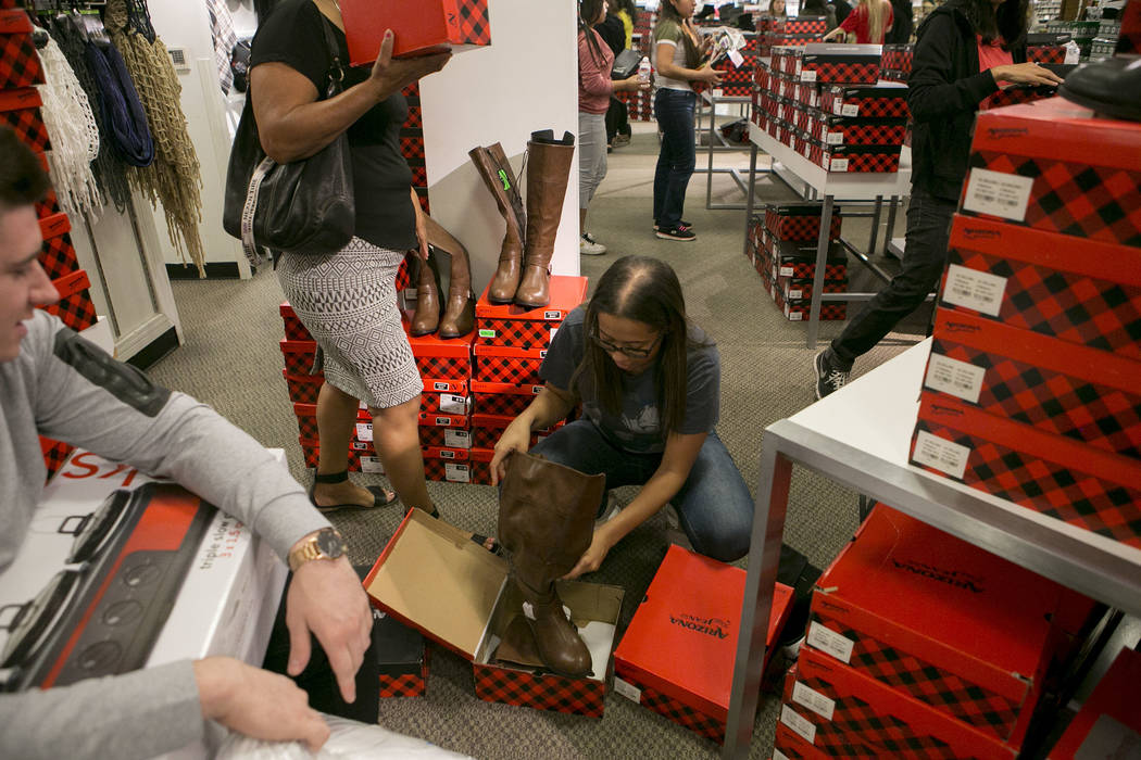 Shopper Mia Davis tries on a pair of boots during Thanksgiving Day shopping at the JCPenney at the Galleria at Sunset in Henderson, Thursday, Nov. 23, 2017. Bridget Bennett Las Vegas Review-Journa ...