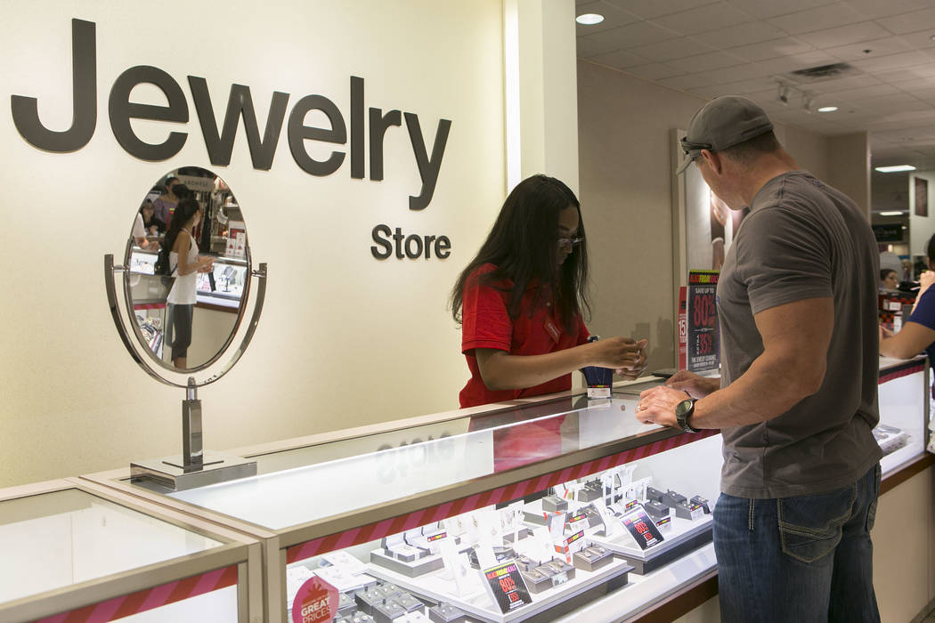 Sale associate Jori Williams helps customers at the jewelry counter during Thanksgiving Day shopping at the JCPenney at the Galleria at Sunset in Henderson, Thursday, Nov. 23, 2017. Bridget Bennet ...