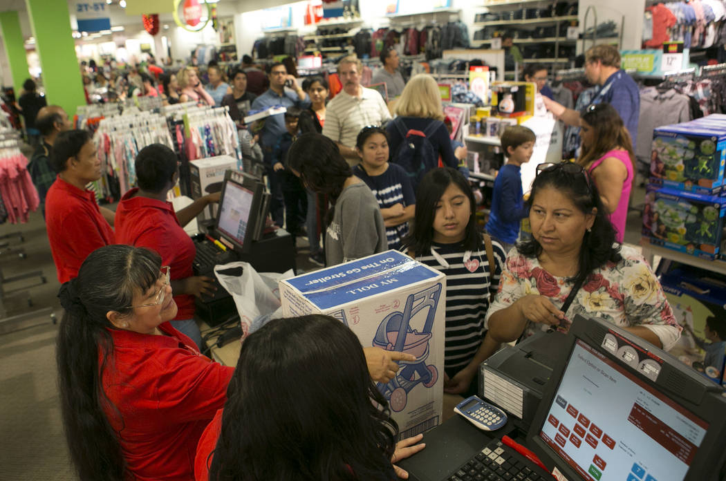 Shoppers wait in line to check out during Thanksgiving Day shopping at the JCPenney at the Galleria at Sunset in Henderson, Thursday, Nov. 23, 2017. Bridget Bennett Las Vegas Review-Journal @Bridg ...