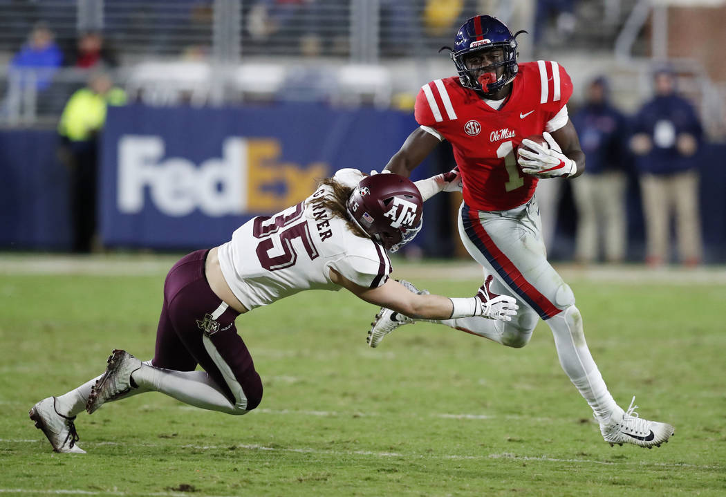 Mississippi wide receiver A.J. Brown (1) slips past a tackle attempt by Texas A&M linebacker Riley Garner (35) during the second half of an NCAA college football game in Oxford, Miss., Saturda ...