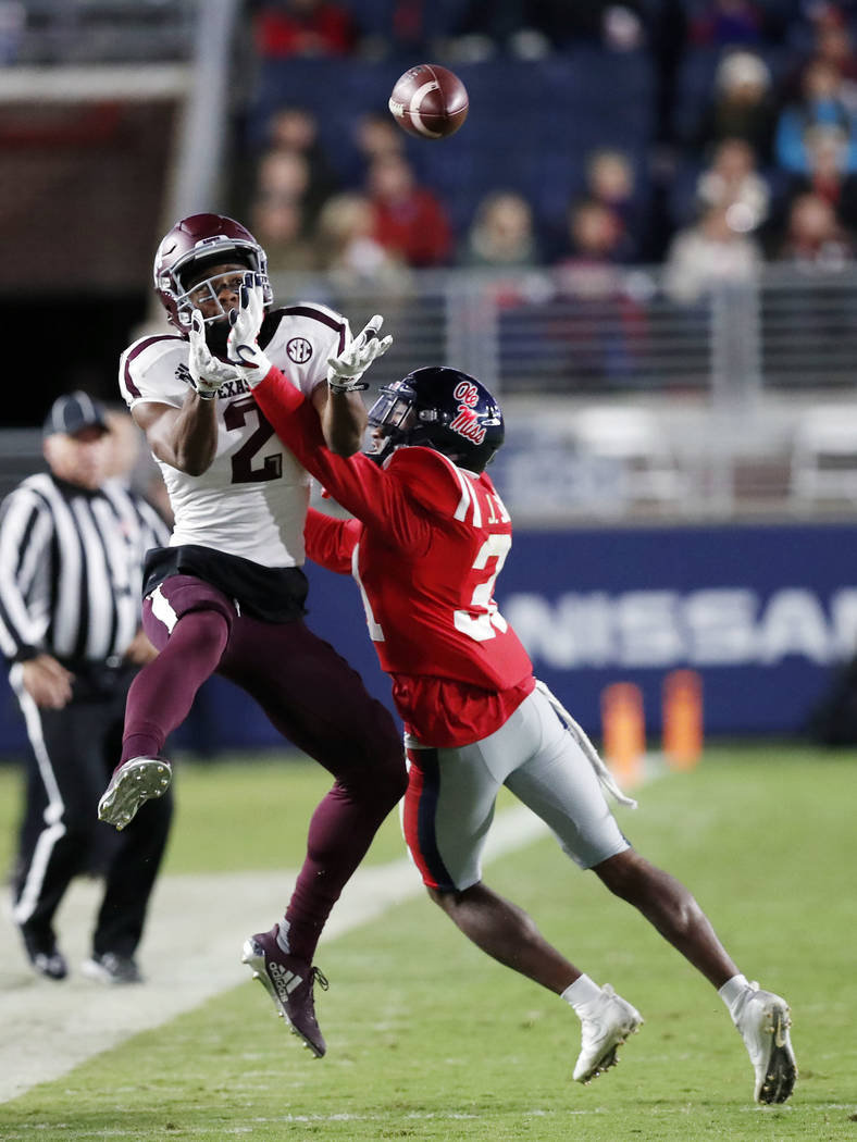 Texas A&M wide receiver Jhamon Ausbon (2) reaches for a pass while Mississippi defensive back Jaylon Jones (31) attempts a block during the first half of an NCAA college football game in Oxfor ...