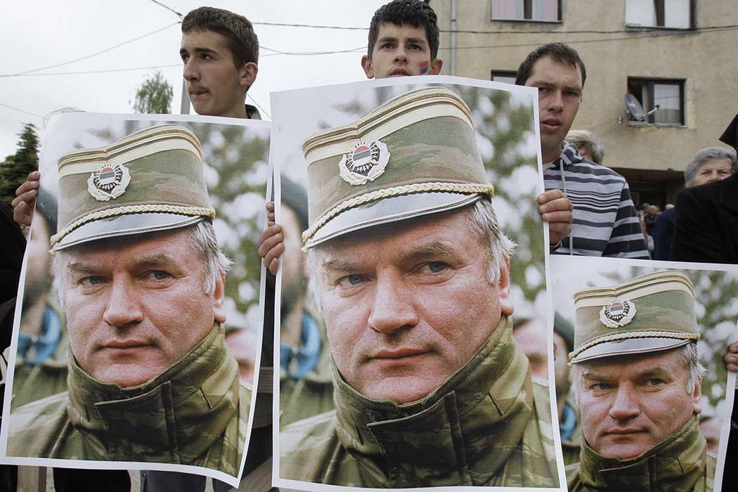A May 29, 2011 file photo shows Bosnian Serb protesters holding posters depicting former Bosnian Serb army chief Ratko Mladic, during a protest in Mladic's hometown of Kalinovik, Bosnia-Herzegovin ...