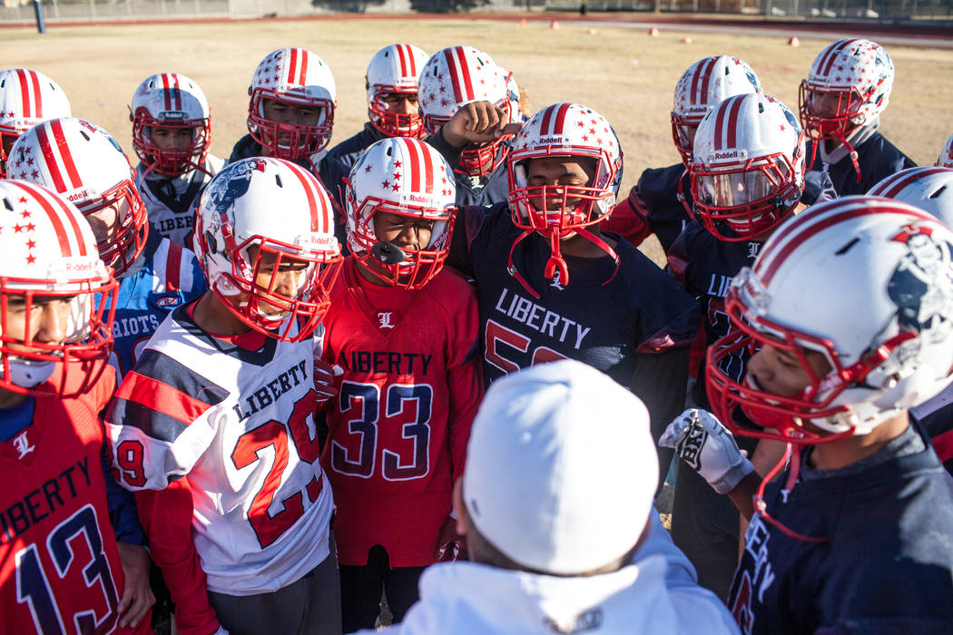 Liberty Patriots special teams players listen to head coach Rich Muraco, center, during a football practice at Liberty High School in Henderson, Thursday, Nov. 23, 2017. Joel Angel Juarez Las Vega ...