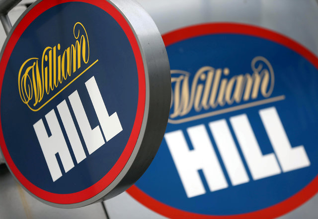 A branded sign is displayed outside a William Hill betting shop. (REUTERS/Neil Hall/File Photo)