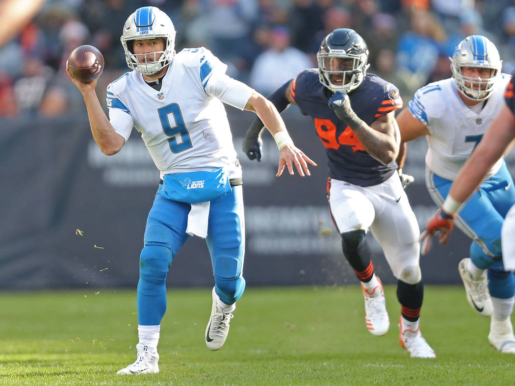 Nov 19, 2017; Chicago, IL, USA; Detroit Lions quarterback Matthew Stafford (9) runs past Chicago Bears outside linebacker Leonard Floyd (94) during the second half at Soldier Field. Mandatory Cred ...