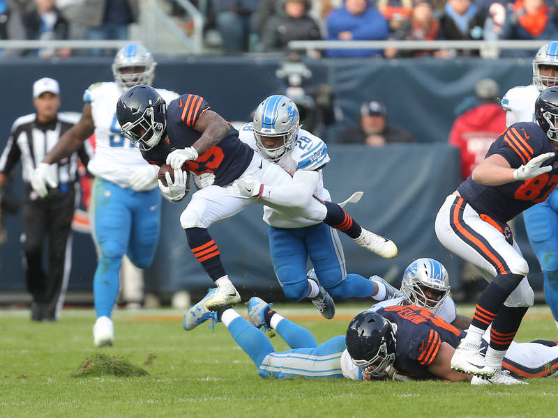 Nov 19, 2017; Chicago, IL, USA; Chicago Bears running back Tarik Cohen (29) runs with the ball with Detroit Lions cornerback Quandre Diggs (28) defending during the second half at Soldier Field. M ...
