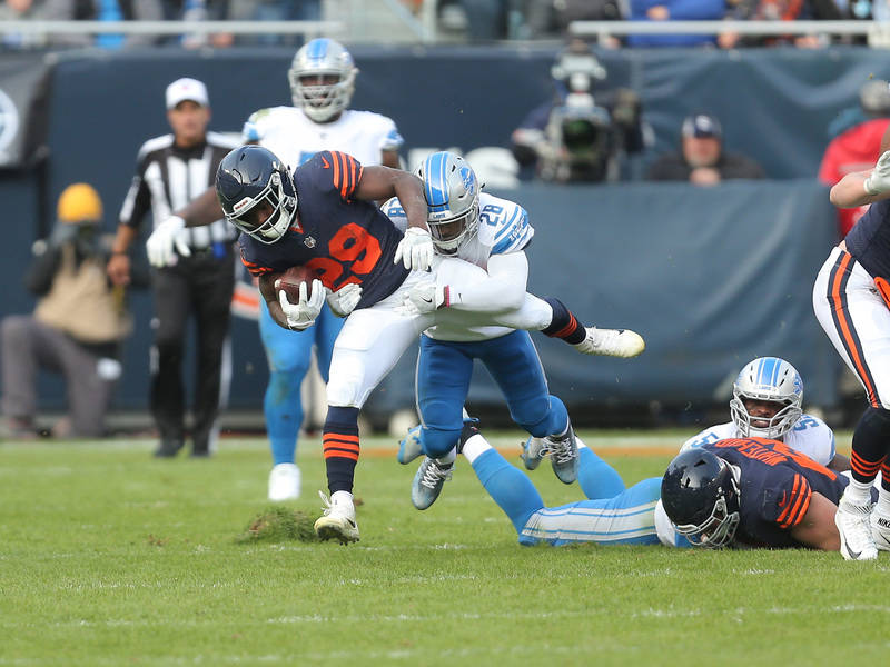 Nov 19, 2017; Chicago, IL, USA; Chicago Bears running back Tarik Cohen (29) is tackled by Detroit Lions cornerback Quandre Diggs (28) during the second half at Soldier Field. Mandatory Credit: Den ...