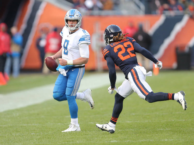 Nov 19, 2017; Chicago, IL, USA; Detroit Lions quarterback Matthew Stafford (9) runs with Chicago Bears cornerback Cre'von LeBlanc (22) defending during the second half at Soldier Field. Mandatory  ...