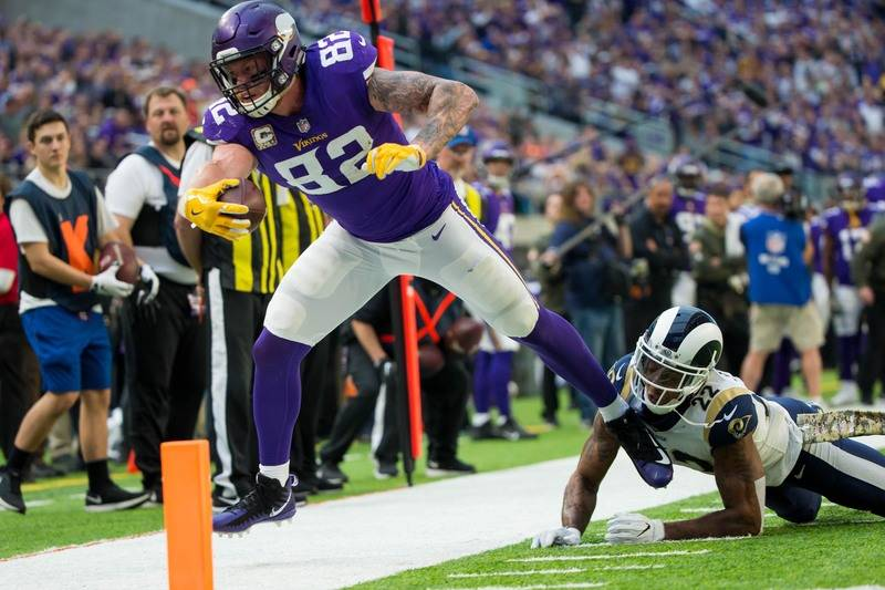 Nov 19, 2017; Minneapolis, MN, USA; Minnesota Vikings tight end Kyle Rudolph (82) catches a pass in the third quarter against the Los Angeles Rams at U.S. Bank Stadium. Mandatory Credit: Brad Remp ...