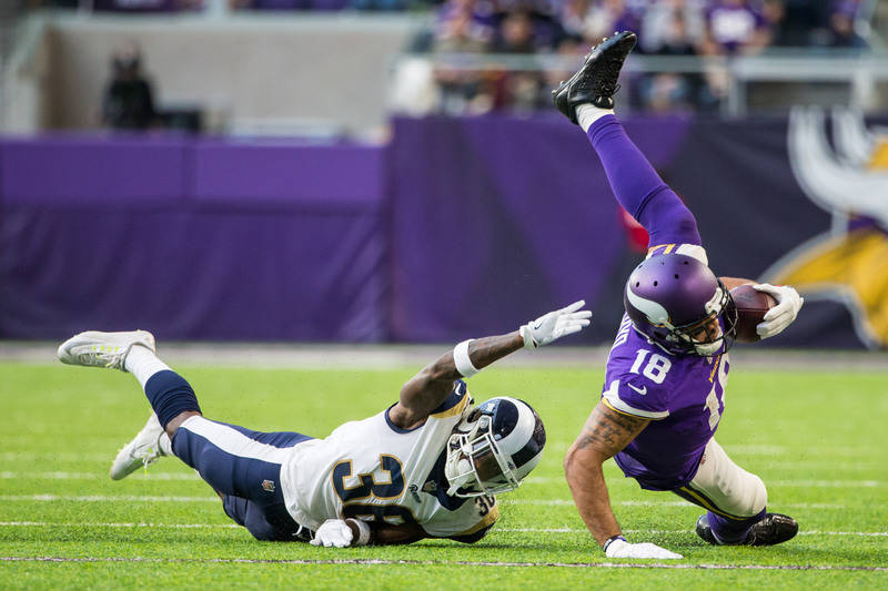 Nov 19, 2017; Minneapolis, MN, USA; Minnesota Vikings wide receiver Michael Floyd (18) is tackled by Los Angeles Rams cornerback Dominique Hatfield (36) during the third quarter at U.S. Bank Stadi ...