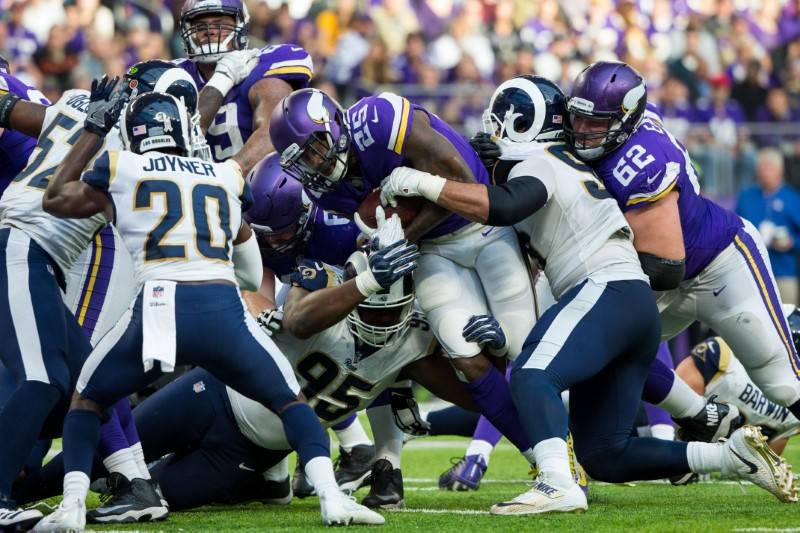 Nov 19, 2017; Minneapolis, MN, USA; Minnesota Vikings running back Latavius Murray (25) scores a touchdown in the fourth quarter against the Los Angeles Rams at U.S. Bank Stadium. Mandatory Credit ...