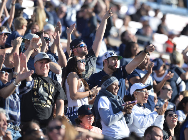 Nevada Wolf Pack fans cheer on their team during the UNLV Nevada football game at Sam Boyd Stadium in Las Vegas on Saturday, Nov. 26, 2016. Brett Le Blanc/Las Vegas Review-Journal Follow @bleblanc ...
