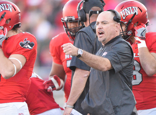 UNLV Rebels head coach Tony Sanchez fist bumps his players during the UNLV Nevada football game at Sam Boyd Stadium in Las Vegas on Saturday, Nov. 26, 2016. Brett Le Blanc/Las Vegas Review-Journal ...