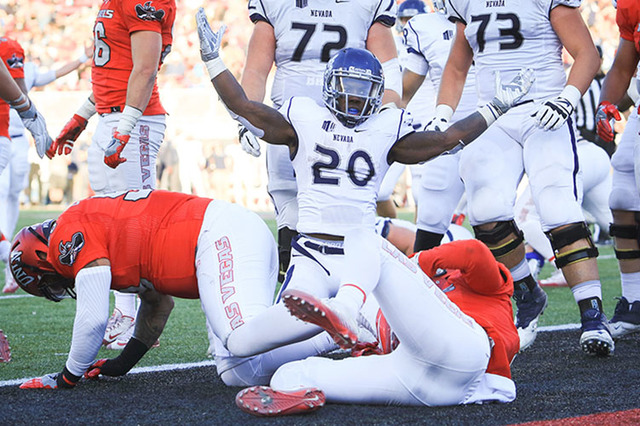 Wolf Pack running back James Butler reacts after scoring a touchdown at Sam Boyd Stadium in Las Vegas on Saturday, Nov. 26, 2016. Nevada beat UNLV 45-10. (Brett Le Blanc/Las Vegas Review-Journal F ...