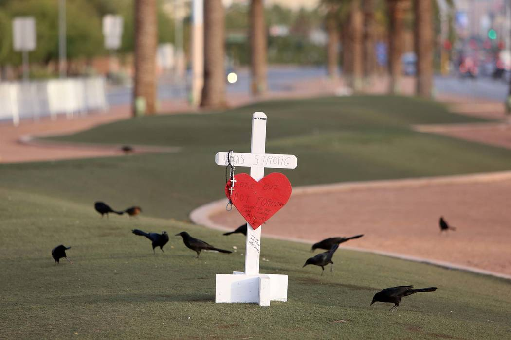 A white cross with Vegas Strong slogan is placed at the Route 91 Harvest memorial site at the Welcome to Fabulous Las Vegas sign, Monday, Oct. 13, 2017. (Bizuayehu Tesfaye/Las Vegas Review-Journal ...