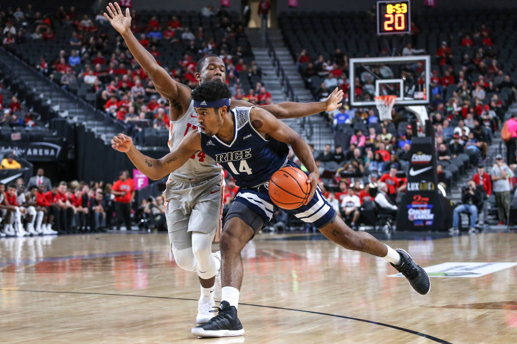 UNLV Rebels guard Jordan Johnson (24), left, blocks Rice Owls guard Najja Hunter (14), right, during the second half of basketball game during day one of the MGM Grand Main Event tournament at T-M ...
