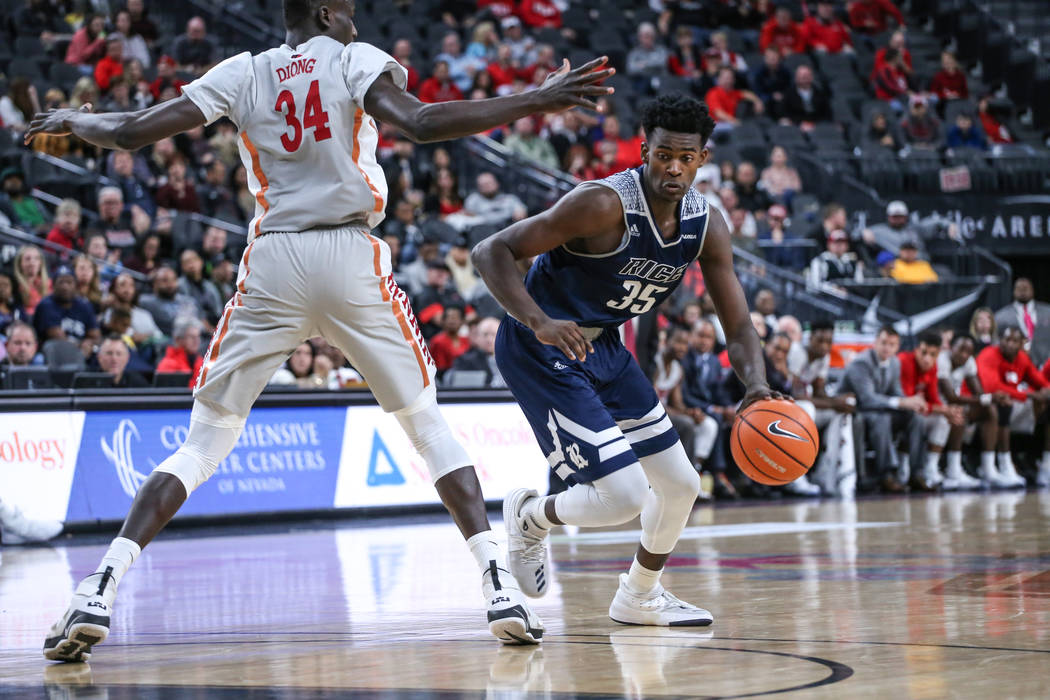 UNLV Rebels forward Cheikh Mbacke Diong (34), left, guards Rice Owls forward Tim Harrison (35), right, during the second half of basketball game during day one of the MGM Grand Main Event tourname ...