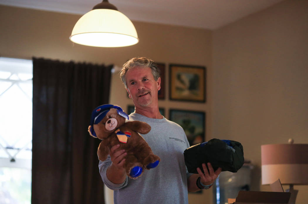 Robert Patterson holds gifts, this time sent by Southwest Airlines, for his children at his home in Lomita, Calif., on Friday, Nov. 17, 2017. Their mother, Lisa Patterson, died at the Route 91 Har ...