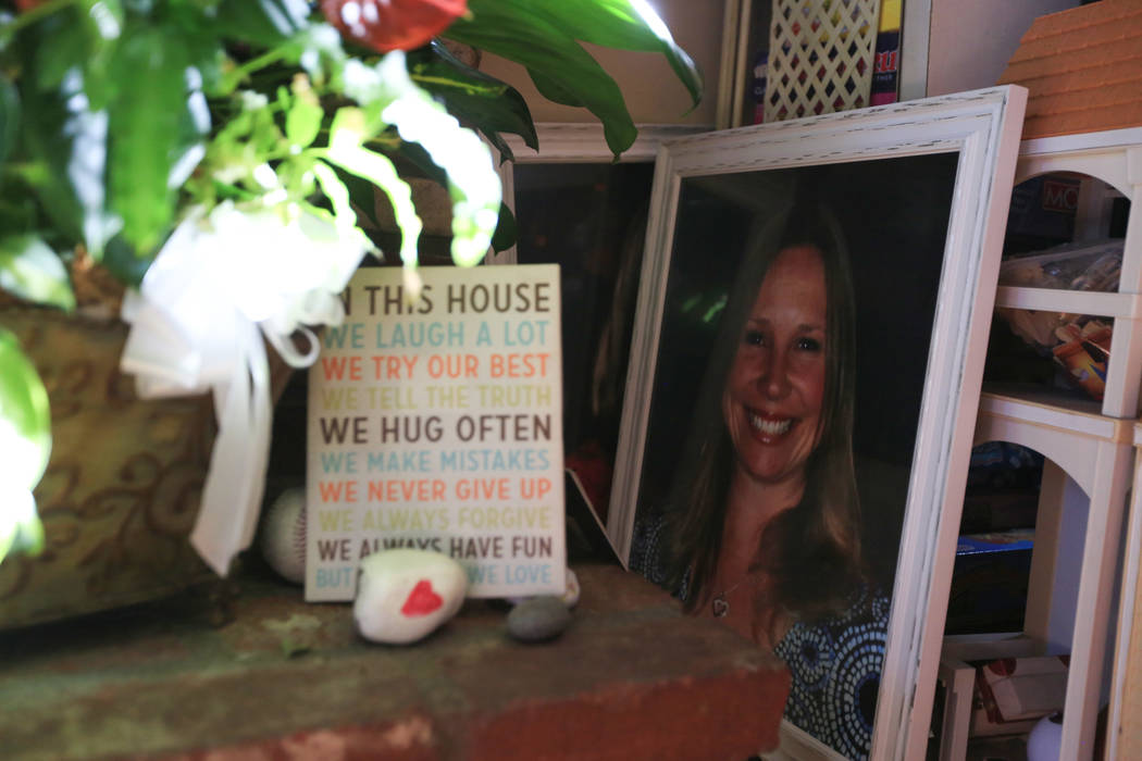 A photo of Lisa Patterson, a victim of the Route 91 Harvest festival shooting, sits near the hearth of her home while her daughter Amber, 19, talks about her mother at their home in Lomita, Calif. ...