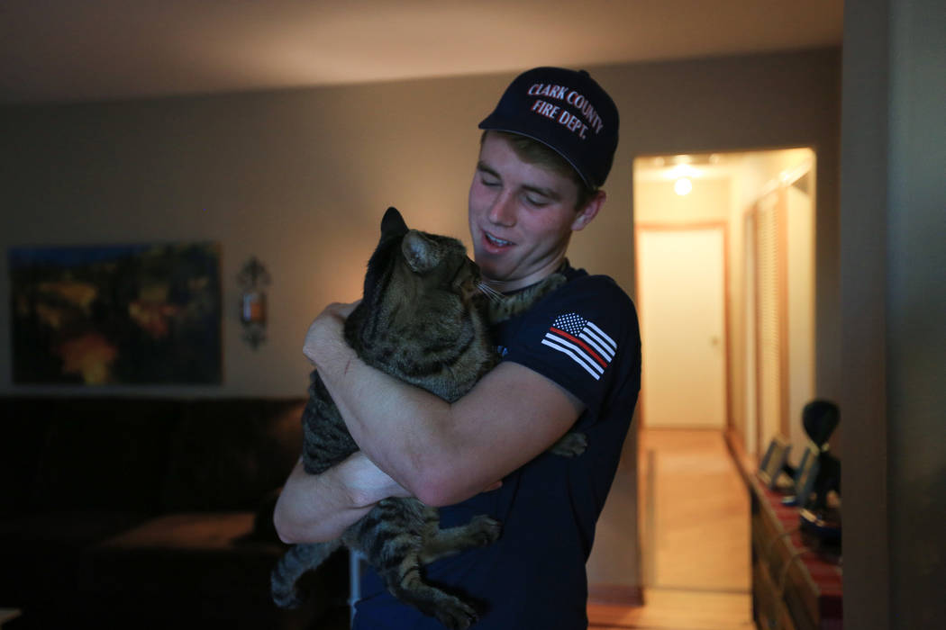 Robert Patterson, 17, holds his cat Boss Man at his home in Lomita, Calif., on Friday, Nov. 17, 2017. His mother, Lisa Patterson, was a victim of the Route 91 Harvest festival shooting. (Brett Le  ...