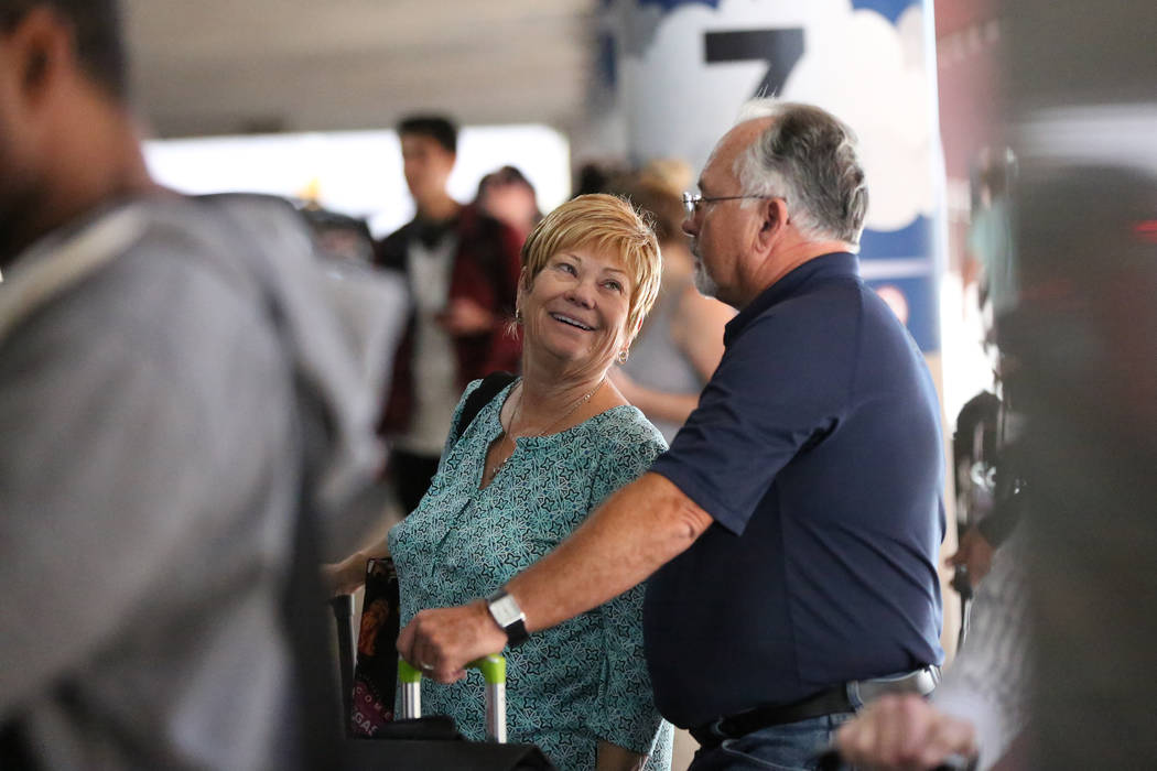 Sharon, left, and Larry Campbell of Fort Myers, Florida, wait for a ride from their son at McCarran International Airport passenger pickup on the day before Thanksgiving, Wednesday, Nov. 22, 2017. ...