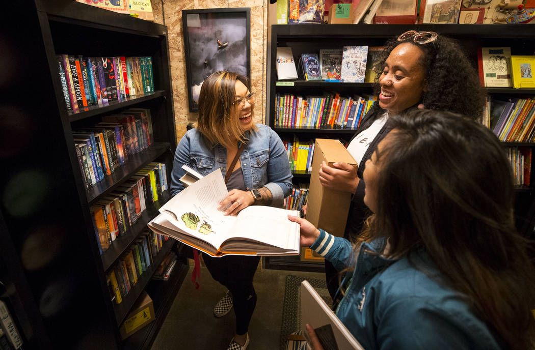 Kristen Panem, from left, Ashia Joseph and Karyn Panem share a laugh as they shop at The Writer's Block on Small Business Saturday, Nov. 25, 2017, in downtown Las Vegas. Richard Brian Las Vegas Re ...