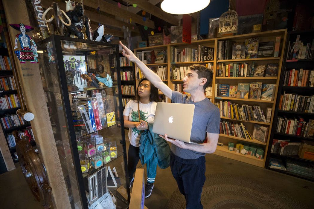 Drew Cohen, right, co-owner of The Writer's Block, helps Karyn Panem as she shops as his store on Small Business Saturday, Nov. 25, 2017, in downtown Las Vegas. Richard Brian Las Vegas Review-Jour ...