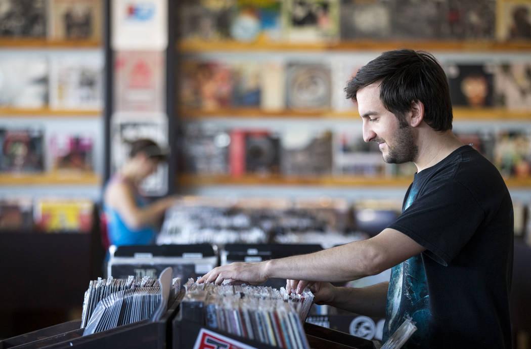 Las Vegas resident Taylor Blake browses the vinyl records at 11th Street Records on Small Business Saturday, Nov. 25, 2017, in downtown Las Vegas. Richard Brian Las Vegas Review-Journal @vegasphot ...