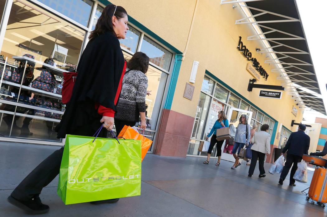 Chitose Suzuki RJRealEstate.Vegas  Shoppers walk through Las Vegas North Premium Outlets in Las Vegas Nov. 15.