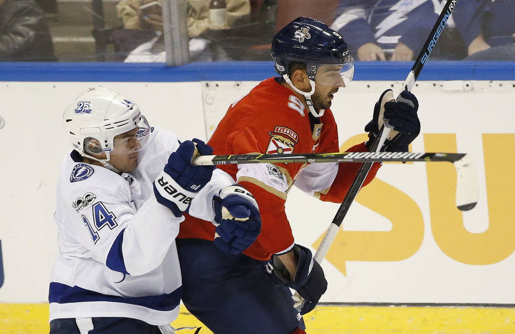 Tampa Bay Lightning left wing Chris Kunitz (14) and Florida Panthers center Brandon Pirri (9) battle for the puck during the third period of an NHL preseason hockey game, Tuesday, Sept. 26, 2017 i ...