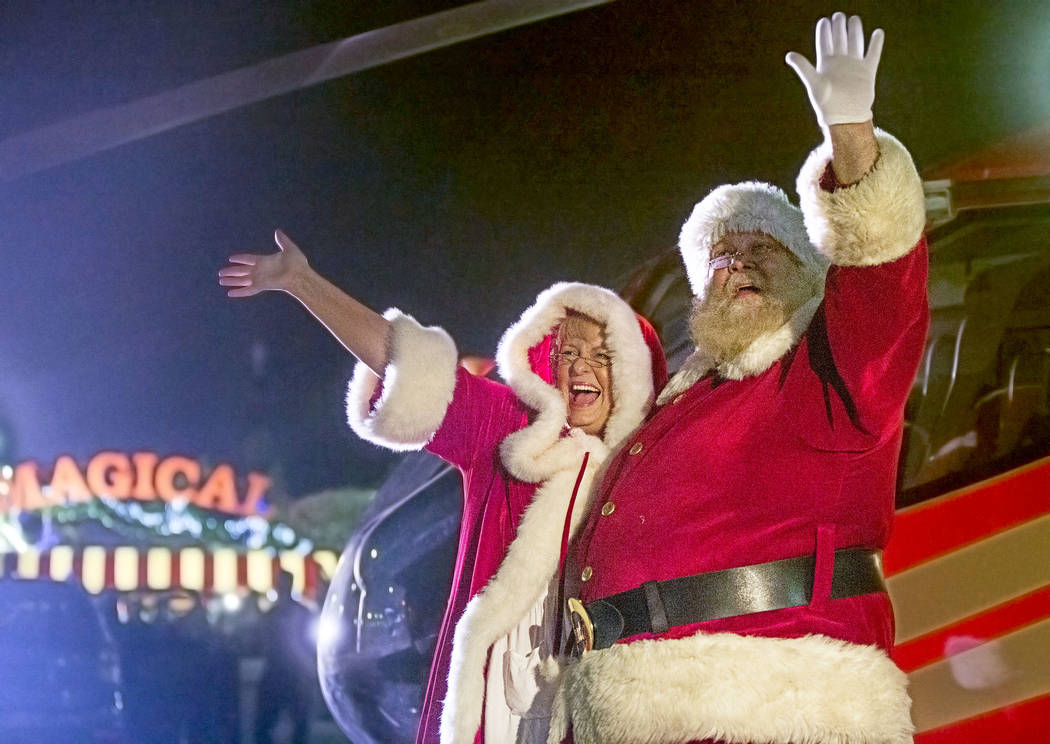 Santa and Mrs. Claus wave to attendees from their Papillon Grand Canyon Helicopter after landing at Opportunity Village's Magical Forest on Friday, Nov. 24, 2017, in Las Vegas. Benjamin Hager Las  ...
