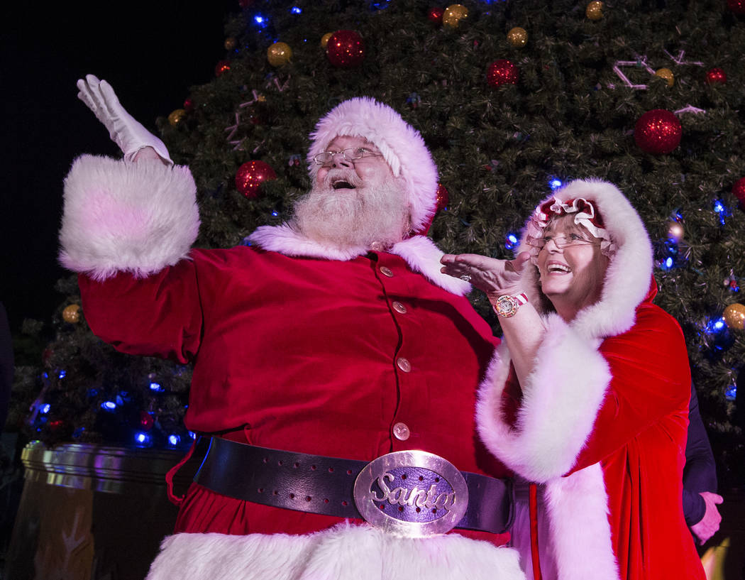 Santa and Mrs. Claus enjoy the fireworks at Opportunity Village's Magical Forest on Friday, Nov. 24, 2017, in Las Vegas. Benjamin Hager Las Vegas Review-Journal @benjaminhphoto