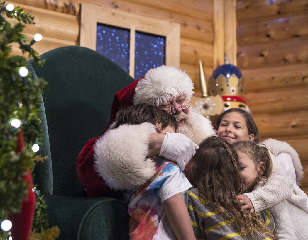 Santa hugs a group of children at Opportunity Village's Magical Forest on Friday, Nov. 24, 2017, in Las Vegas. Benjamin Hager Las Vegas Review-Journal @benjaminhphoto