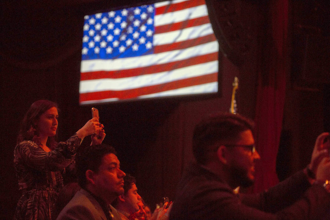 Family and friends take photos as new graduates are presented with their badges and diplomas during a Las Vegas Metropolitan Police Department graduation ceremony at The Orleans hotel-casino in La ...